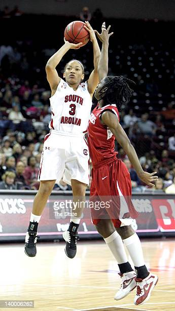 South Carolina Gamecocks guard Ieasia Walker shoots over Arkansas Lady Razorbacks forward Keira Peak during the first half at Colonial Life Arena in...