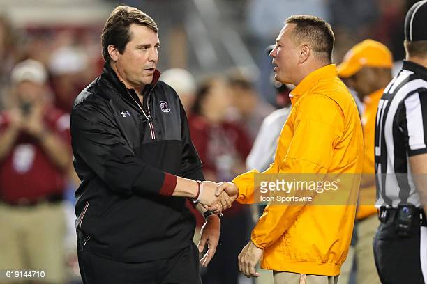 South Carolina Gamecocks head coach Will Muschamp and Tennessee Volunteers head coach Butch Jones shake hands on October 29 at WilliamsBrice Stadium...