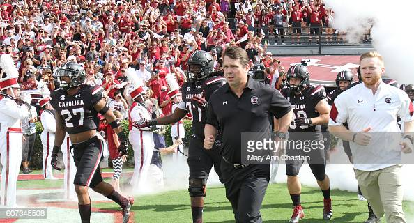 South Carolina Gamecocks head football coach Will Muschamp runs onto the field in their home opener agains the East Carolina Pirates at WilliamsBrice...