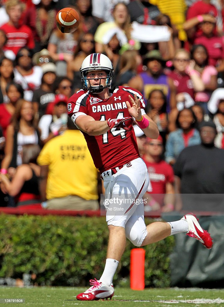 South Carolina Gamecocks quarterback <a gi-track='captionPersonalityLinkClicked' href=/galleries/search?phrase=Connor+Shaw+-+American+Football+Player&family=editorial&specificpeople=9849665 ng-click='$event.stopPropagation()'>Connor Shaw</a> (14) delivers a pass to tailback Marcus Lattimore in the first quarter. The South Carolina Gamecocks defeated the Kentucky Wildcats, 54-3, at Williams-Brice Stadium, in Columbia, South Carolina, Saturday, October 8, 2011.