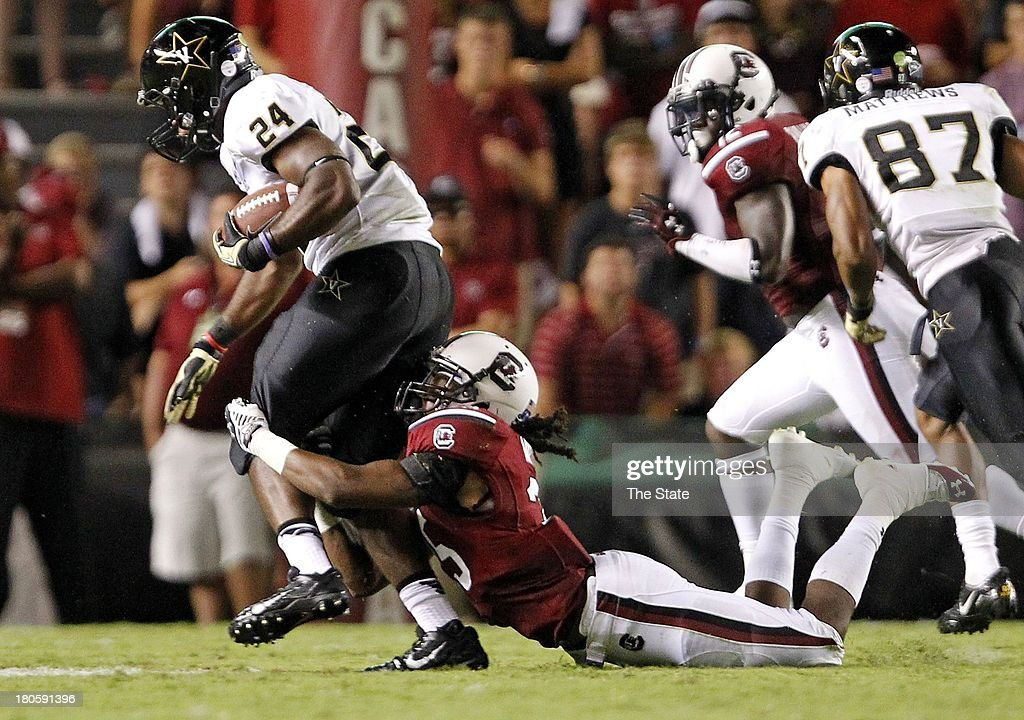 South Carolina Gamecocks safety Kadetrix Marcus (25) brings down Vanderbilt Commodores running back Wesley Tate (24) in the second half at Williams-Brice Stadium in Columbia, South Carolina, Saturday, September 14, 2013. South Carolina defeated Vanderbilt, 35-25.