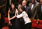South Carolina Gov Nikki Haley is hugged during the funeral of Ethel Lance who was one of nine victims of a mass shooting at the Emanuel African...