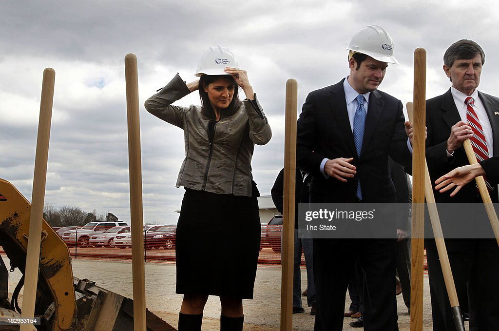 South Carolina Gov. Nikki Haley, middle, adjusts her hard hat as she prepares to take part in the South Carolina Inland Port groundbreaking in Greer, South Carolina, Friday, March 1, 2013. More than 200 port users, stakeholders, community leaders and elected officials came together to break ground on the new site.