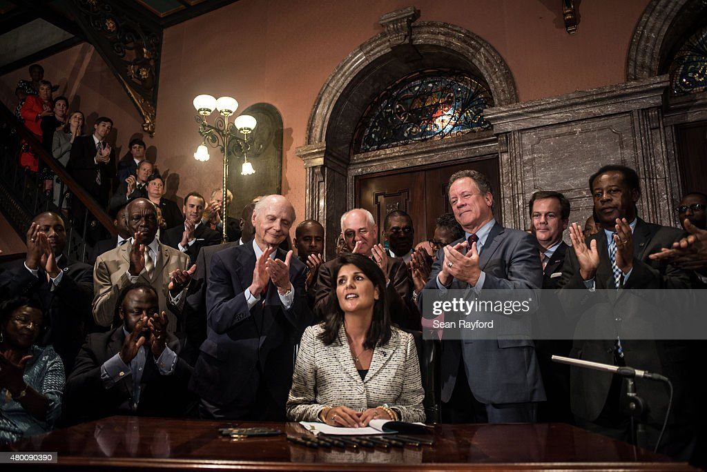South Carolina Gov. <a gi-track='captionPersonalityLinkClicked' href=/galleries/search?phrase=Nikki+Haley+-+Governor&family=editorial&specificpeople=6974701 ng-click='$event.stopPropagation()'>Nikki Haley</a> receives applause after signing a bill to remove the Confederate battle flag from the state house grounds July 9, 2015 in Columbia, South Carolina. Debate on the flag was reignited three weeks ago after the mass murder at Emanuel AME Church in Charleston, South Carolina.
