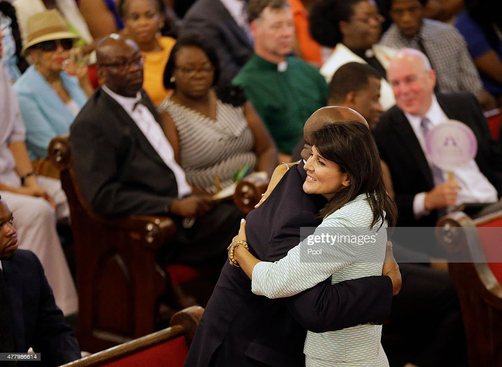 South Carolina Gov. Nikki Haley, R-S.C., embraces U.S. Sen Tim Scott, R-S.C., at the Emanuel A.M.E. Church four days after a mass shooting that claimed the lives of Pinckney and eight others at the historic Emanuel African Methodist Church June 21, 2015 in Charleston, South Carolina. Chruch elders decided to hold the regularly scheduled Sunday school and worship service as they continue to grieve the shooting death of nine of its members including its pastor earlier this week.