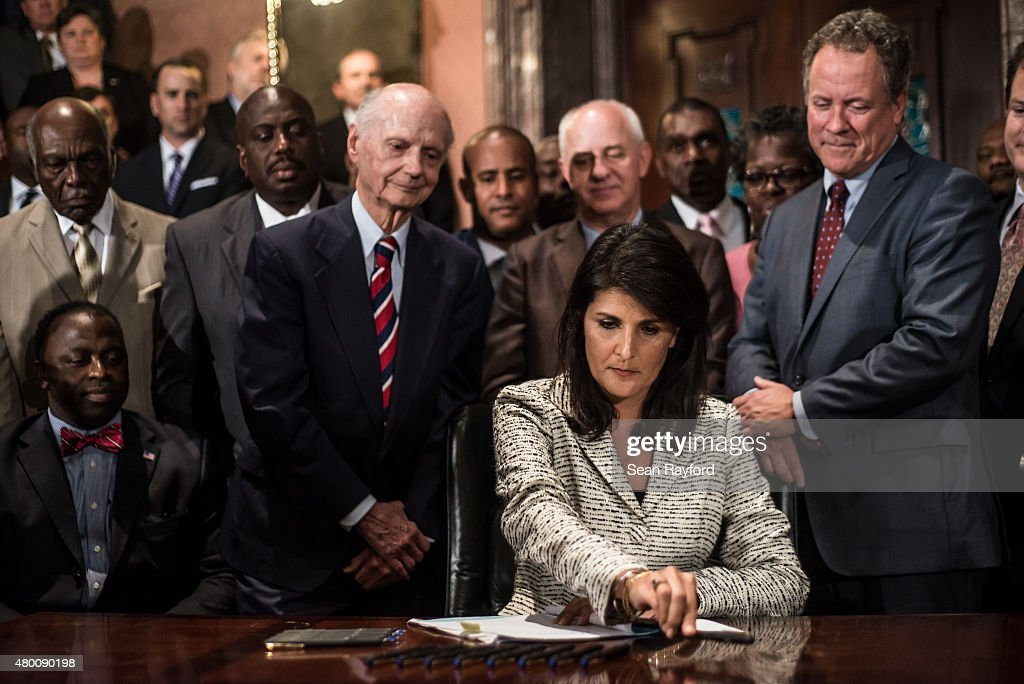 South Carolina Gov. <a gi-track='captionPersonalityLinkClicked' href=/galleries/search?phrase=Nikki+Haley+-+Governor&family=editorial&specificpeople=6974701 ng-click='$event.stopPropagation()'>Nikki Haley</a> signs a bill to remove the Confederate battle flag from the state house grounds July 9, 2015 in Columbia, South Carolina. Debate on the flag was reignited three weeks ago after the mass murder at Emanuel AME Church in Charleston, South Carolina.