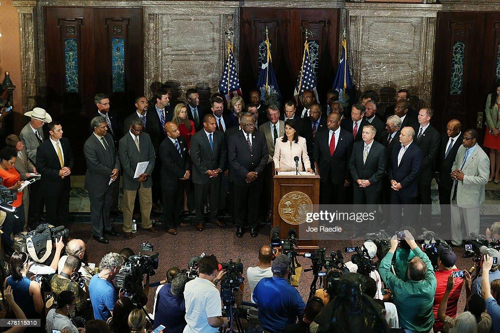 South Carolina Gov Nikki Haley surrounded by lawmakers and activists speaks to the media asking that the Confederate flag be removed from the state...