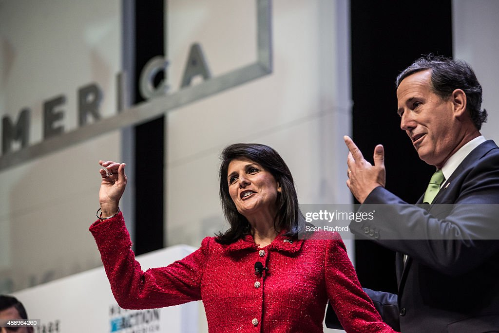 South Carolina Governor and forum moderator Nikki Haley and Sen Rick Santorum speak to voters at the Heritage Action Presidential Candidate Forum...