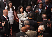 South Carolina Governor Nikki Haley greets people after signing a bill to remove the Confederate flag from the statehouse on July 9 2015 in Columbia...
