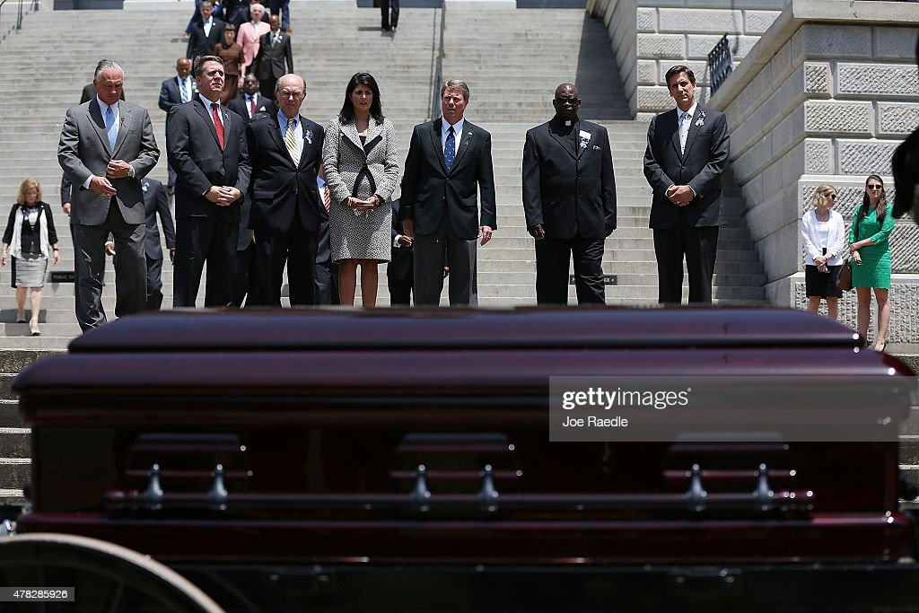South Carolina Governor Nikki Haley looks on at the coffin while standing with other lawmakers as South Carolina Highway Patrol Honor Guard prepare...