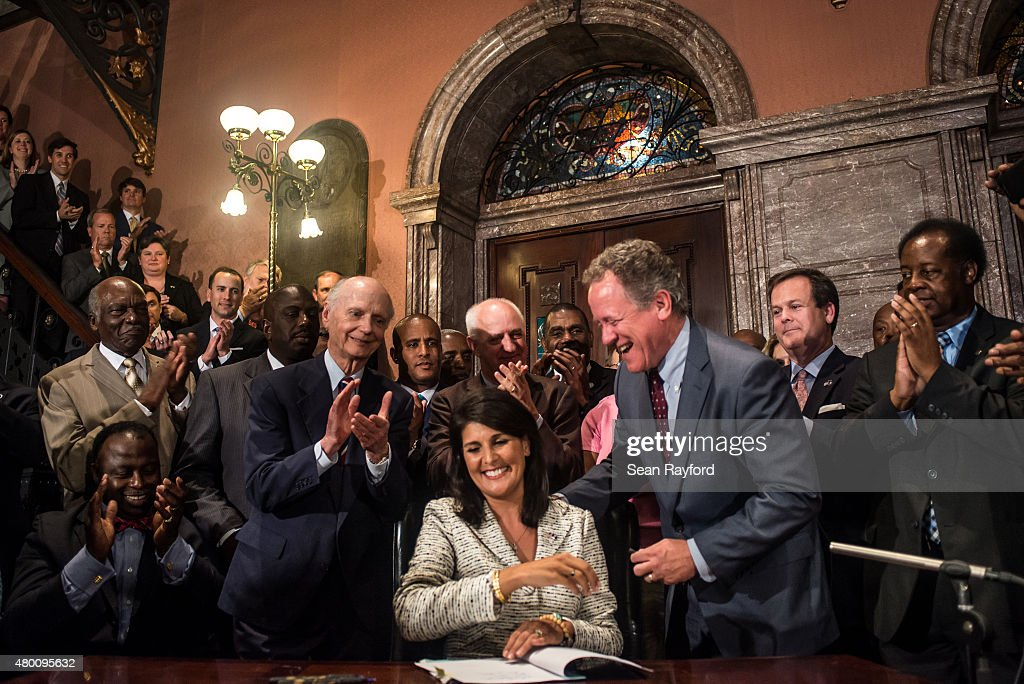 South Carolina Governor <a gi-track='captionPersonalityLinkClicked' href=/galleries/search?phrase=Nikki+Haley+-+Governor&family=editorial&specificpeople=6974701 ng-click='$event.stopPropagation()'>Nikki Haley</a> signs a bill to remove the Confederate battle flag from the state house grounds July 9, 2015 in Columbia, South Carolina. Debate on the flag was reignited three weeks ago after the mass murder at Emanuel AME Church in Charleston, South Carolina.