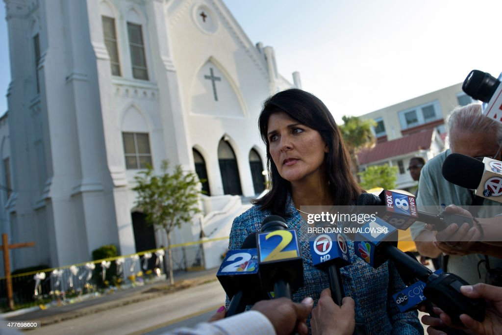 South Carolina Governor Nikki Haley speaks to press outside the Emanuel AME Church June 19 2015 in Charleston South CarolinaUS police arrested a...