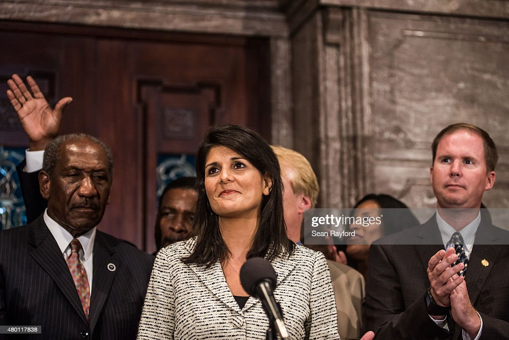South Carolina Governor Nikki Haley stands with state lawmakers July 9 2015 in Columbia South Carolina Haley signed a bill Thursday afternoon...