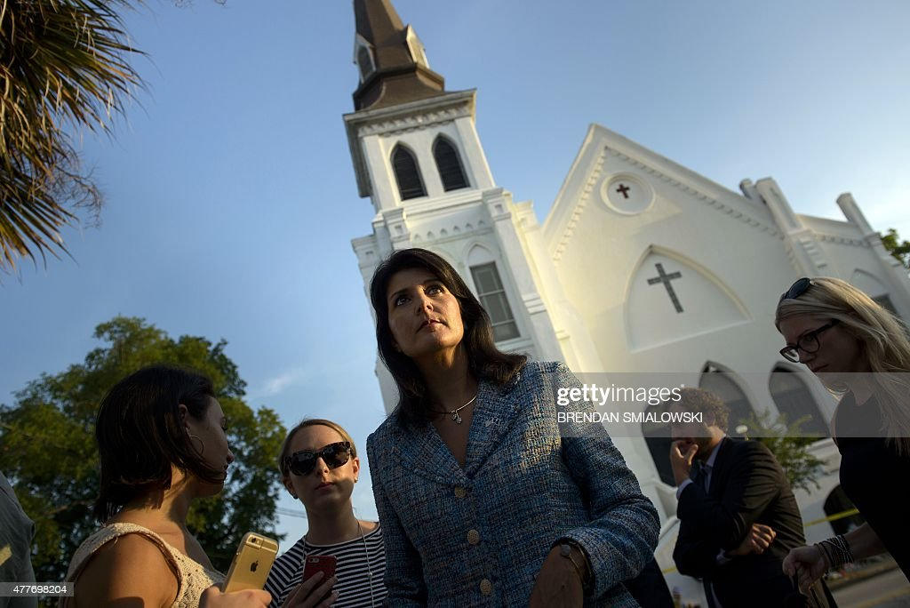 South Carolina Governor Nikki Haley waits to speak to press outside the Emanuel AME Church June 19 2015 in Charleston South Carolina US police...