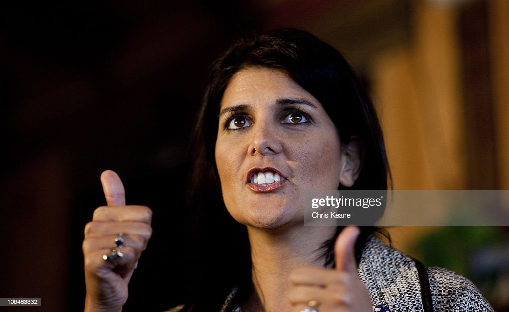 South Carolina Governor-elect <a gi-track='captionPersonalityLinkClicked' href=/galleries/search?phrase=Nikki+Haley+-+Gouverneur&family=editorial&specificpeople=6974701 ng-click='$event.stopPropagation()'>Nikki Haley</a> speaks to voters at Hudson's Smokehouse on November 3, 2010 in Lexington, South Carolina.The election of Haley makes her the first Indian-American governor of South Carolina when she beat incumbent Democrat Vincent Sheheen.