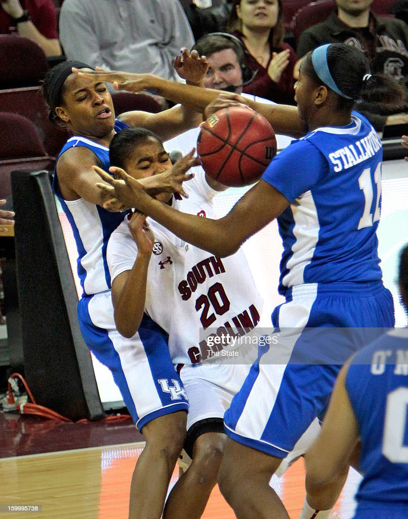 South Carolina guard Sancheon White (20) battles Kentucky center DeNesha Stallworth (11) for a rebound during a women's college basketball game at Colonial Life Arena in Columbia, South Carolina, Thursday, January 24, 2013. The South Carolina Gamecocks defeated the Kentucky Wildcats, 55-50.