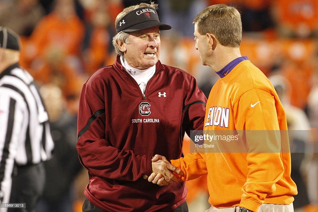 South Carolina head coach Steve Spurrier and Clemson head coach Dabo Swinney shake hands prior to their game at Memorial Stadium on Saturday, November 24, 2012, in Clemson, South Carolina.