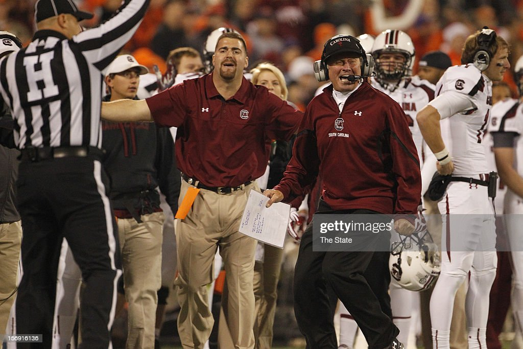 South Carolina head coach Steve Spurrier questions a flag in the third quarter of their game at Memorial Stadium on Saturday, November 24, 2012, in Clemson, South Carolina.