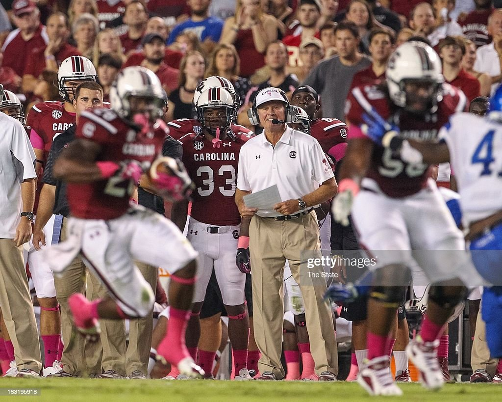 South Carolina head coach Steve Spurrier watches running back Mike Davis gain yardage during the first half against Kentucky at WilliamsBrice Stadium...