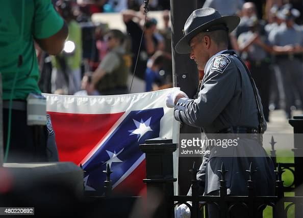 South Carolina honor guard lowers the Confederate flag from the Statehouse grounds on July 10 2015 in Columbia South Carolina Republican Governor...