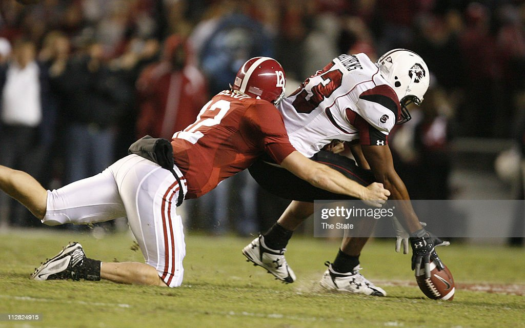 South Carolina junior defensive end Cliff Matthews recovers a fumble in front of Alabama quarterback Greg McElroy in the second quarter at...