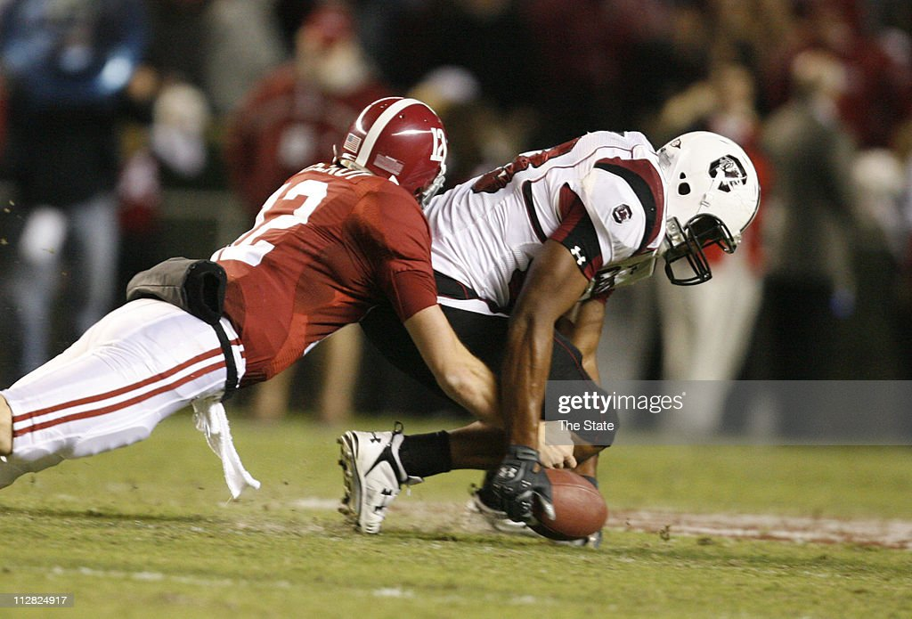 South Carolina junior defensive end Cliff Matthews recovers a fumble in front of Alabama quarterback Greg McElroy in the second quarter at Bryant-Denny Stadium in Tuscaloosa, Alabama, Saturday, October 17, 2009.