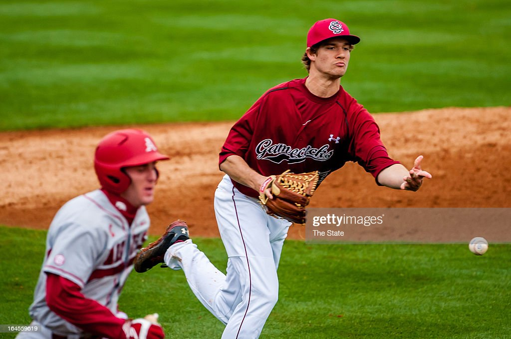 South Carolina pitcher Jack Wynkoop throws out Matt Vinson of Arkansas on a sacrifice during the fourth inning in Columbia, South Carolina, Sunday, March 24, 2013.