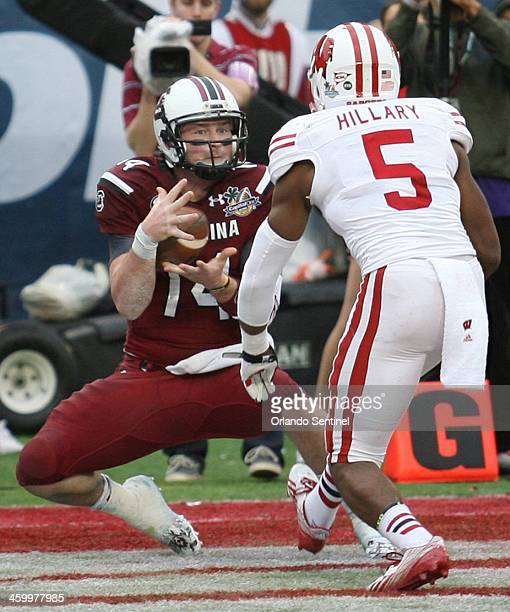 South Carolina quarterback Connor Shaw catches a touchdown pass in front of Wisconsin cornerback Darius Hillary in the Capital One Bowl on Wednesday...