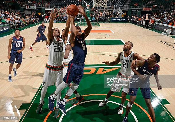 South Carolina State forward Ozante Fields shoots against Miami forward Dewan Huell during an NCAA basketball game between the South Carolina State...