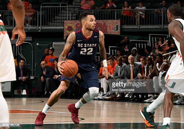 South Carolina State guard Eric Eaves dribbles during an NCAA basketball game between the South Carolina State Bulldogs and the University of Miami...