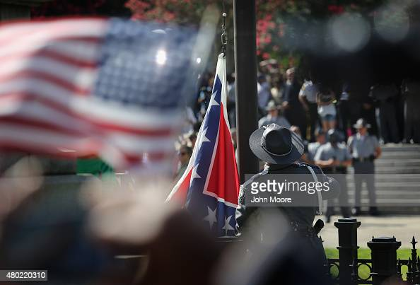South Carolina state police honor guard lowers the Confederate flag from the Statehouse grounds on July 10 2015 in Columbia South Carolina Republican...