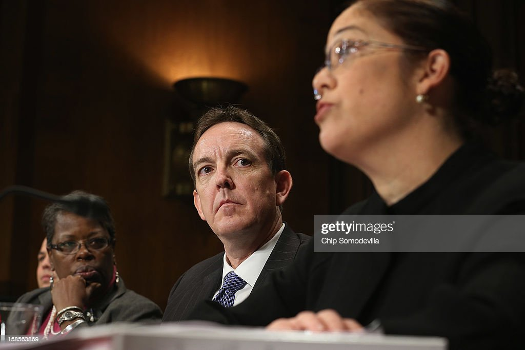 South Carolina State Rep. Gilda Cobb-Hunter (L) and Arizona Secretary of State Ken Bennett (C) listens to Mexican American Legal Defense and Educational Fund Vice President of Litigation Nina Perales as they testify before the Senate Judiciary Committee about voter rights at the Dirksen Senate Office Building on Capitol Hill December 19, 2012 in Washington, DC. According to the committee, the hearing focused on Americans' access to the voting booth 'and the continuing need for protections against efforts to limit or suppress voting.'