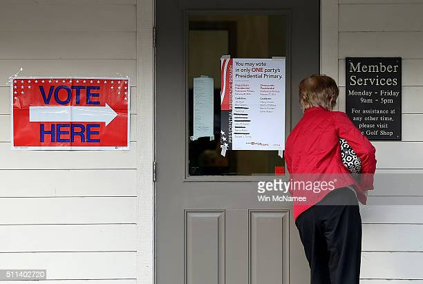 South Carolina voter enters the polling station at the Bear Creek Golf Club as voters cast their ballots February 20 2016 in Hilton Head Island South...