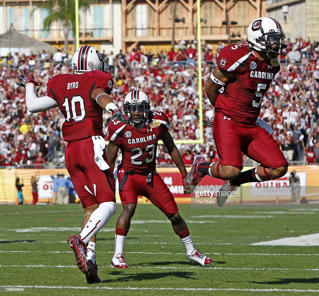 South Carolina wide receiver Damiere Byrd, left, celebrates his 56-yard touchdown catch in the first quarter against Michigan in the Outback Bowl at Raymond James Stadium in Tampa, Florida, on Tuesday, January 1, 2013.
