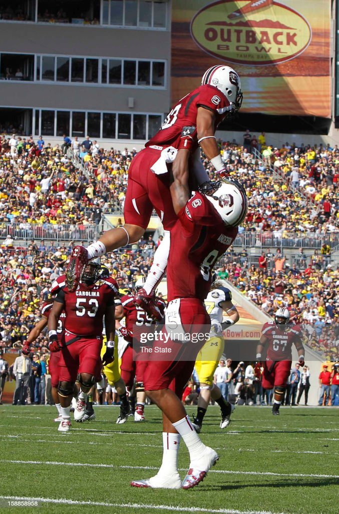 South Carolina wide receiver Damiere Byrd, top, celebrates his 56-yard touchdown catch in the first quarter against Michigan in the Outback Bowl at Raymond James Stadium in Tampa, Florida, on Tuesday, January 1, 2013.