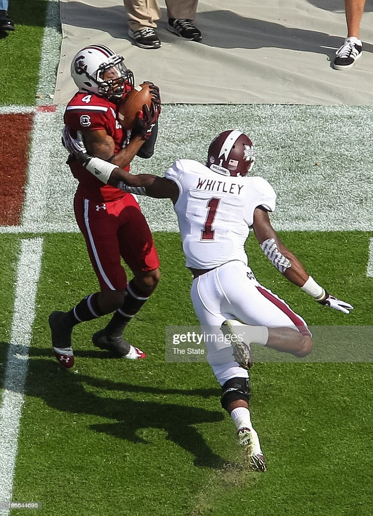 South Carolina wide receiver Shaq Roland (4) catches a touchdown pass during the first half against Mississippi State at Williams-Brice Stadium in Columbia, South Carolina, on Saturday, November 2, 2013.