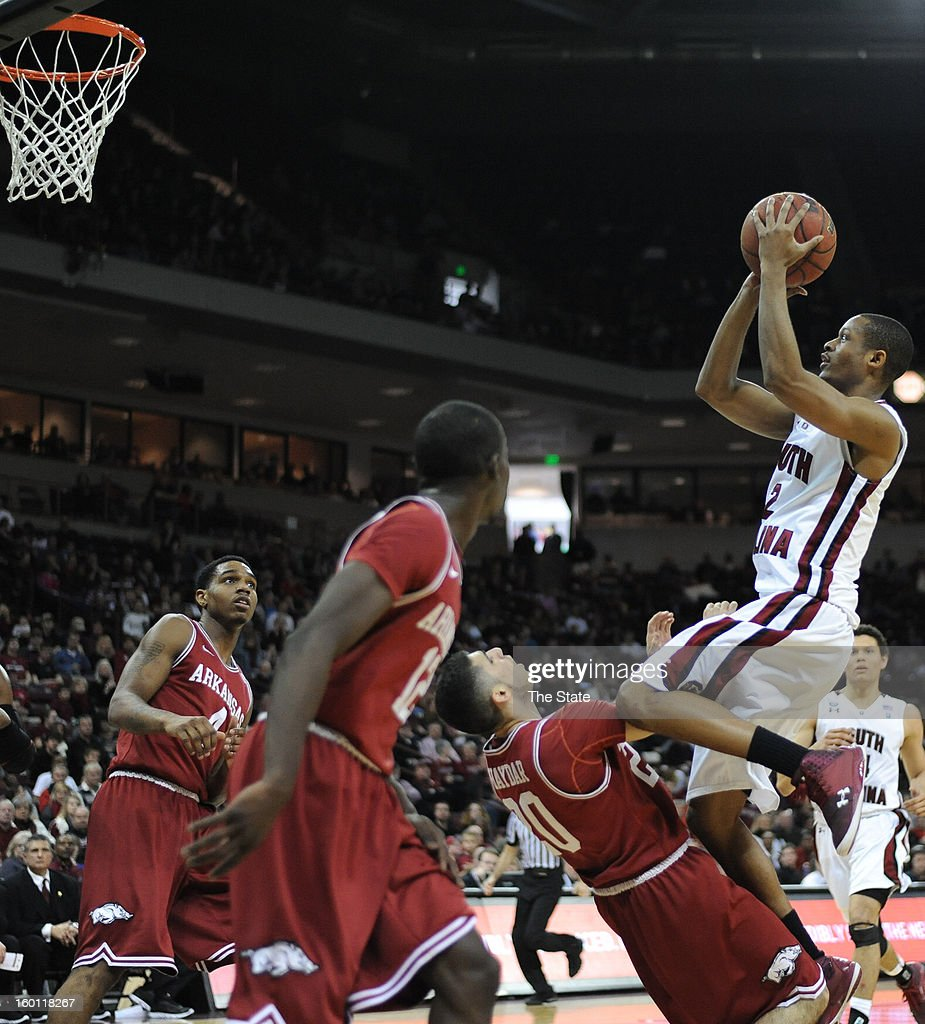 South Carolina's Brian Richardson scores over Arkansas' Kikko Haydar in the second half at Colonial Life Arena in Columbia, South Carolina, on Saturday, January 26, 2013. South Carolina won, 75-54.