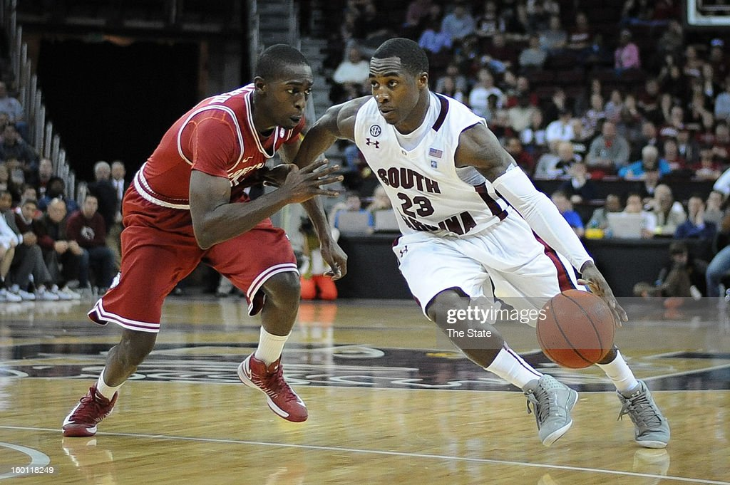 South Carolina's Bruce Ellington (23) drives against Arkansas' Fred Gulley in the second half at Colonial Life Arena in Columbia, South Carolina, on Saturday, January 26, 2013. South Carolina won, 75-54.