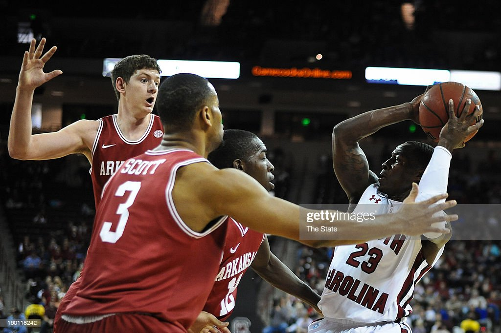 South Carolina's Bruce Ellington (23) is triple-teamed in the first half against Arkansas at Colonial Life Arena in Columbia, South Carolina, on Saturday, January 26, 2013. South Carolina won, 75-54.