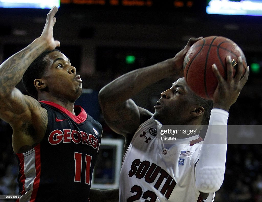 South Carolina's Bruce Ellington, right, is defended by Georgia's Vincent Williams in the first half at the Colonial Life Arena in Columbia, South Carolina, on Saturday, February 2, 2013. Georgia won, 67-56.