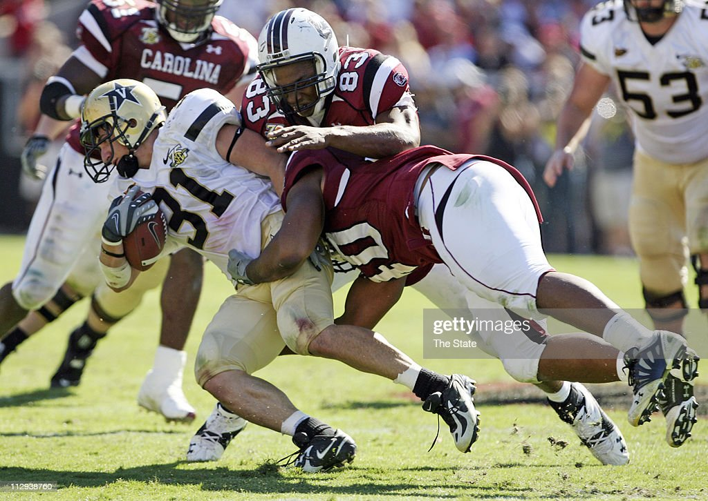 South Carolina's Cliff Matthews (83) and Eric Norwood tackle Vanderbilt's Jared Hawkins in the third quarter. The Commodores defeated the Gamecocks 17-6 at Williams-Brice Stadium in Columbia, South Carolina, Saturday, October 20, 2007.