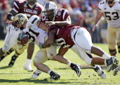 South Carolina's Cliff Matthews and Eric Norwood tackle Vanderbilt's Jared Hawkins in the third quarter The Commodores defeated the Gamecocks 176 at...