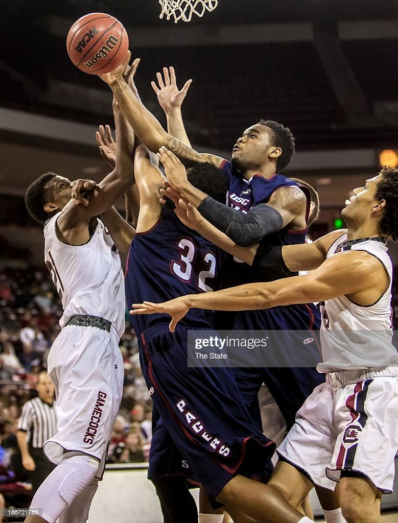 South Carolina's Demetrius Henry (21), USC Aiken forward Alvin Brown (32) and USC Aiken guard Shane Porchea (5) battle for a rebound during an exhibition game at Colonial Life Arena in Columbia, South Carolina, Sunday, Novembe 3, 2013.