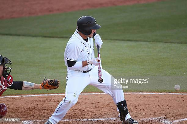 South Carolina's Graham Saiko advances two runners in the fourth inning with a sac bunt against Rider at Carolina Stadium in Columbia South Carolina...