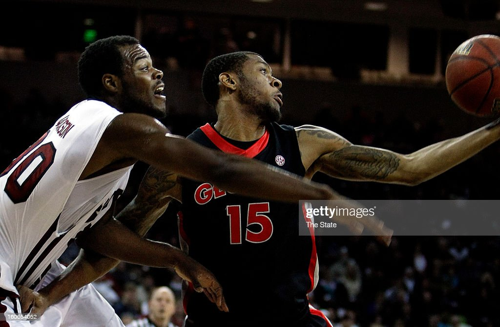 South Carolina's Lakeem Jackson, left, tries to make a steal against Georgia's Donte' Williams in the first half at the Colonial Life Arena in Columbia, South Carolina, on Saturday, February 2, 2013. Georgia won, 67-56.