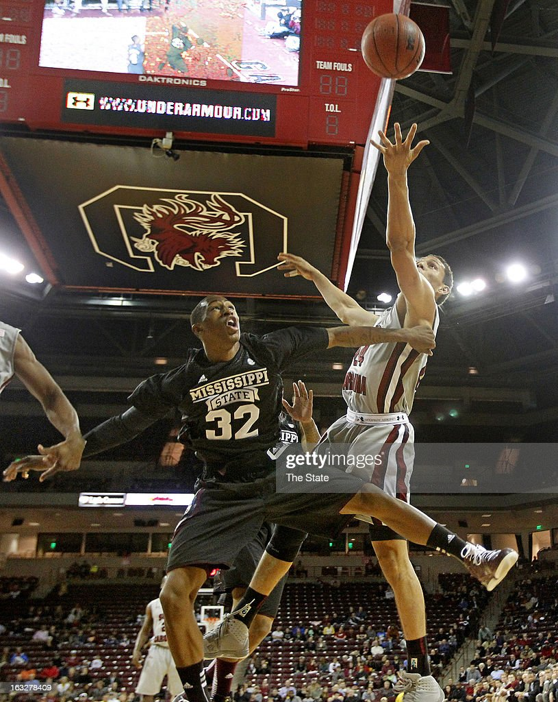 South Carolina's Michael Carrera grabs a rebound over Mississippi State's Craig Sword at the Colonial Life Arena in Columbia, South Carolina, on Wednesday, March 6, 2013. The host Gamecocks won, 79-72.