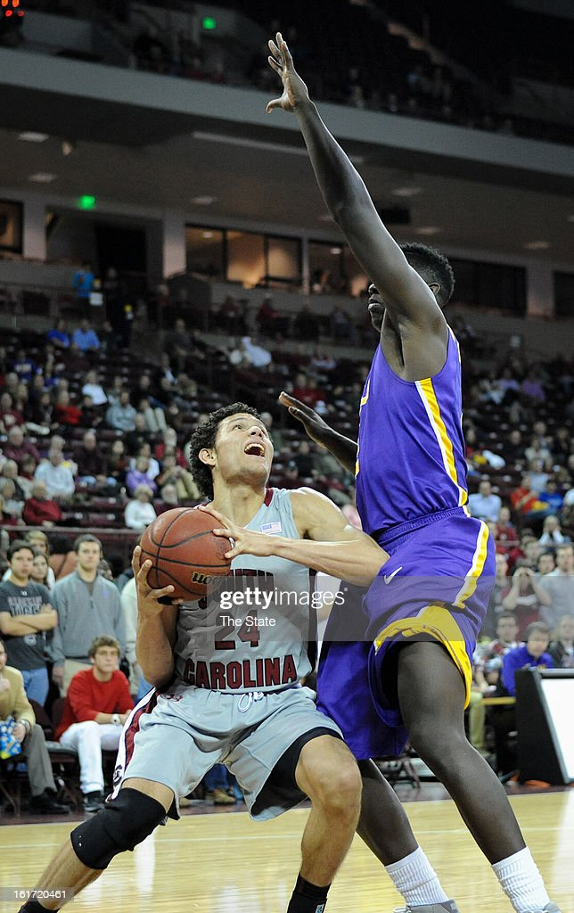 South Carolina's Michael Carrera is well covered by Louisiana State's Johnny O'Bryant III, right, at Colonial Life Arena in Columbia, South Carolina, on Thursday, February 14, 2013. LSU pulled away for a 64-46 win.