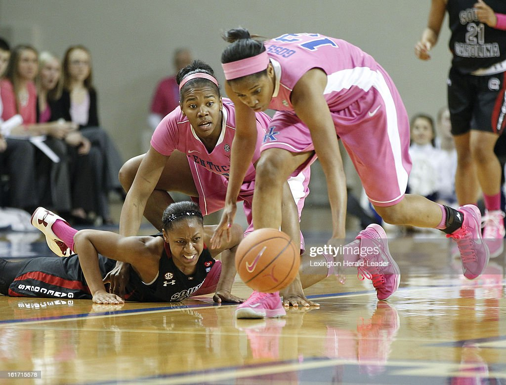 South Carolina's Tiffany Mitchell, left, loses the ball as Kentucky's DeNesha Stallworth pressures and Bria Goss, right, picks it up at Memorial Coliseum in Lexington, Kentucky, on Thursday, February 14, 2013.