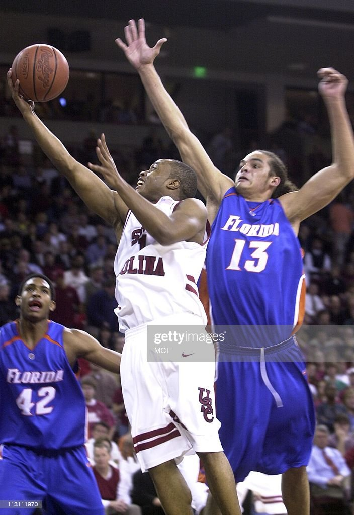 South Carolina's Tre Kelley drives to the basket against Florida's Joakim Noah during first period action at The Colonial Center in Columbia, South Carolina, Wednesday, January 25, 2006.