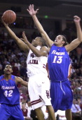 South Carolina's Tre Kelley drives to the basket against Florida's Joakim Noah during first period action at The Colonial Center in Columbia South...